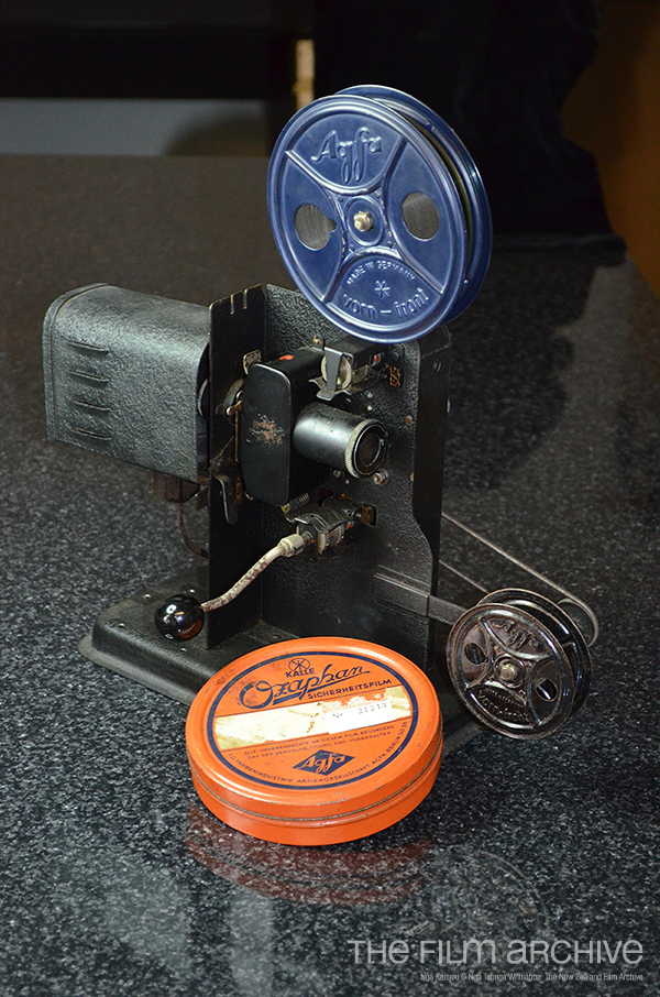 Reiner's 16mm toy projector, with can of Ozaphan film.