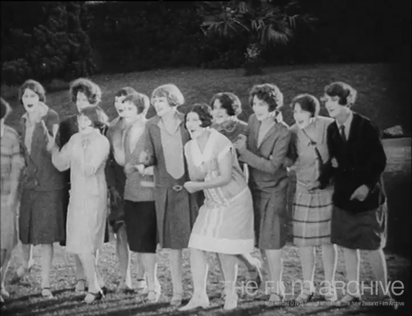 Auckland semi-finalists in the Miss New Zealand 1927 competition cheering on a rugby game at Carlaw Park.