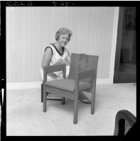 Doreen Kelso with the chair in which she sat at the investiture of the Prince of Wales (which we hold in the Sound Archives Ngā Taonga Kōrero collection). Further negatives of the 'Evening Post' newspaper. Ref: EP/1969/5235-F. Alexander Turnbull Library, Wellington, New Zealand. http://natlib.govt.nz/records/23217966