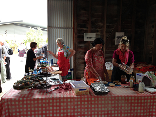 Elegantly dressed locals served snacks at the Aramoana Woolshed screening.