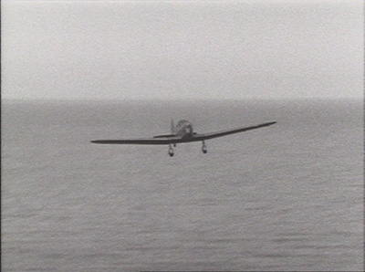 Batten's plane appears on the horizon.  Image: Jean Batten - Garbo of the Skies (Ian MacKersey, 1988).