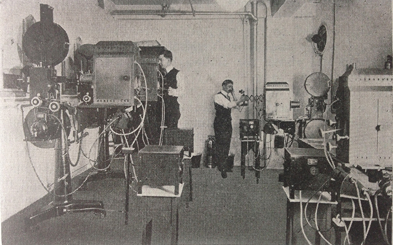 The projection room at Pathé's American headquarters, p. 249 Motion Picture Handbook.