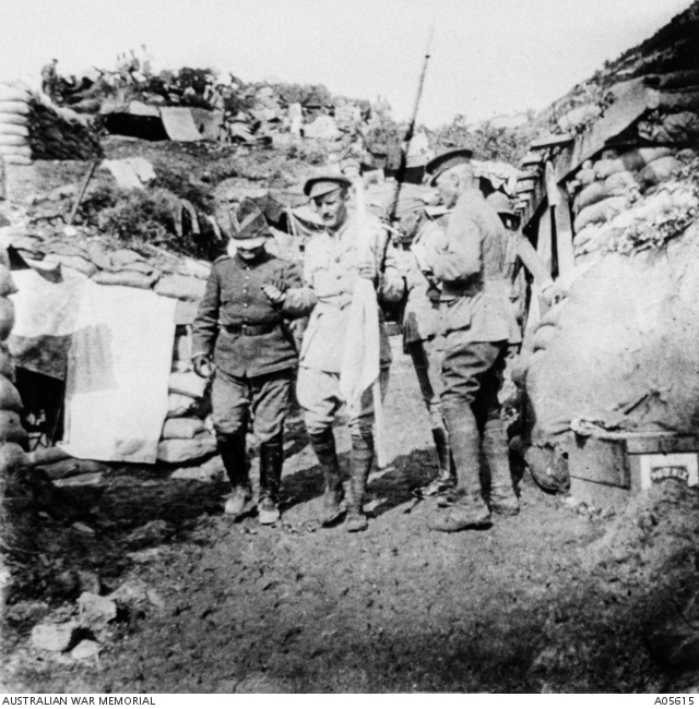 Gallipoli Peninsula, Turkey. 22 May 1915. Captain Sam Butler, holding the white truce flag, leads the blindfolded Turkish envoy Major Kemal Ohri from General Birdwood's Headquarters to return to the Turkish lines after arranging the burial armistice for 24 May 1915.