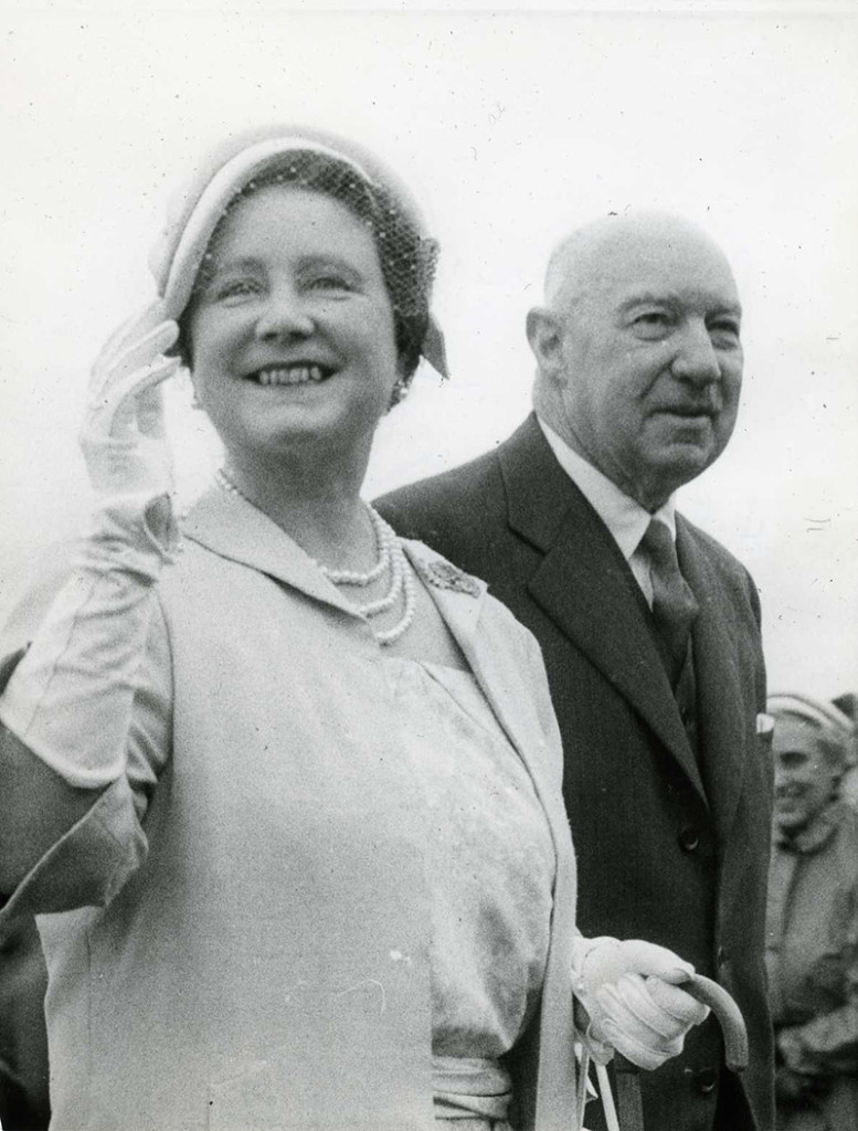 8 February 1958, Queen Elizabeth the Queen Mother with Mr H.R. Chalmers, President of the Wellington Racing Club. Upper Hutt Public Library (Ref: P2-46-122).  [CC license]