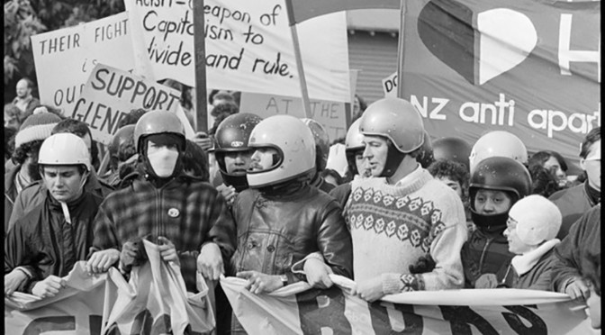 Protesters in Hamilton during a demonstration against the 1981 Springbok tour - Photograph taken by Phil Reid. Dominion post (Newspaper) : Photographic negatives and prints of the Evening Post and Dominion newspapers. Ref: EP/1981/2599/3-F. Alexander Turnbull Library, Wellington, New Zealand. http://natlib.govt.nz/records/22551319