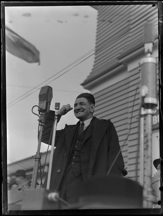 John Alfred Alexander Lee, Labour Under-Secretary, giving a speech [Orakei, Auckland?]. Whites Aviation Ltd : Photographs. Ref: WA-67319-G. Alexander Turnbull Library, Wellington, New Zealand. http://natlib.govt.nz/records/22857067
