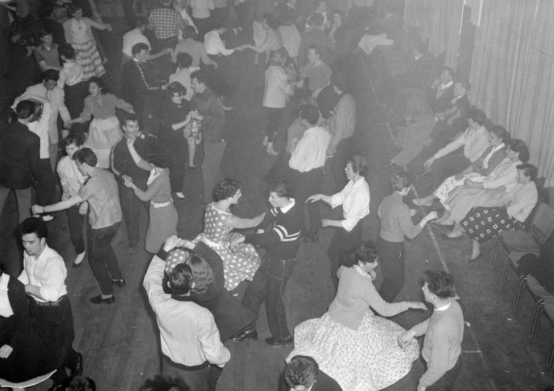 [Detail of] Rock and roll dancers at Youth Club, Taita, Lower Hutt. Evening post (Newspaper. 1865-2002) : Photographic negatives and prints of the Evening Post newspaper. Ref: EP/1957/3619-F. Alexander Turnbull Library, Wellington, New Zealand. http://natlib.govt.nz/records/22744683
