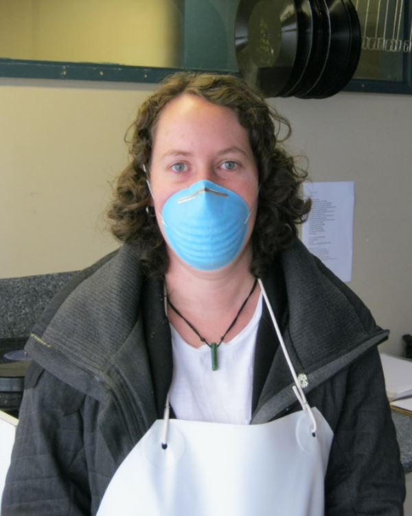 Sandy Ditchburn wearing protective clothing during the disc cleaning process.