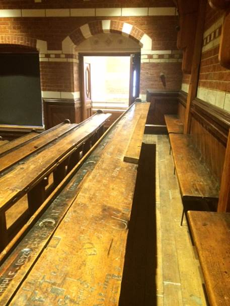 The historic 1877 Christchurch lecture theatre where Rutherford studied, with original seating and desks.