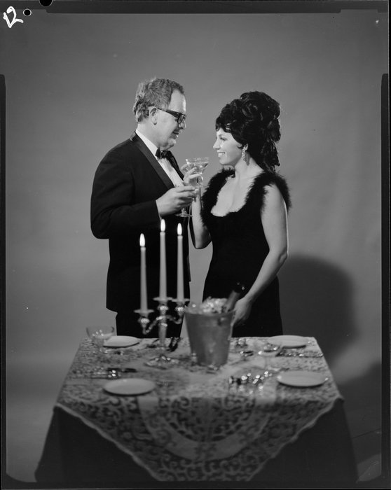 Couple drinking wine. K E Niven and Co :Commercial negatives. Ref: 1/2-225711-F. Alexander Turnbull Library, Wellington, New Zealand. http://natlib.govt.nz/records/22810341