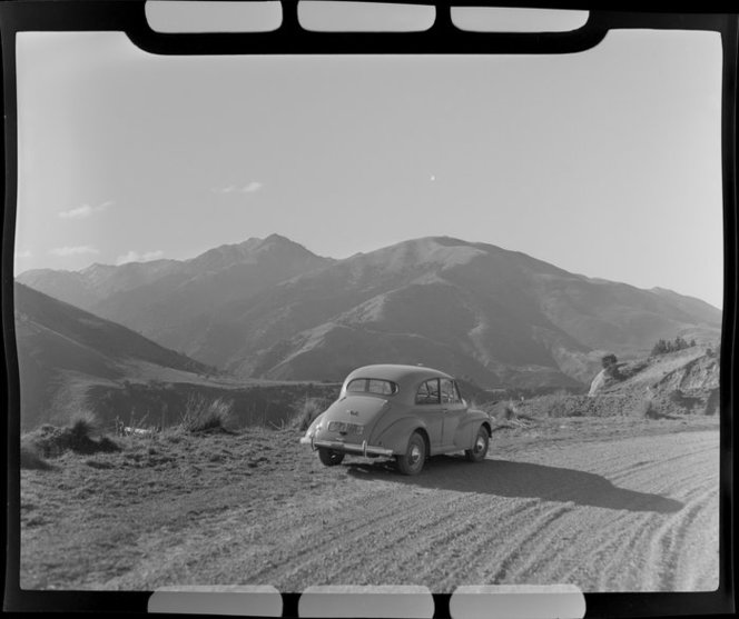 Morris Minor car, Kaikoura Coast Road, Hundalee Hills, Marlborough 1950. Whites Aviation Ltd. http://natlib.govt.nz/records/22853922