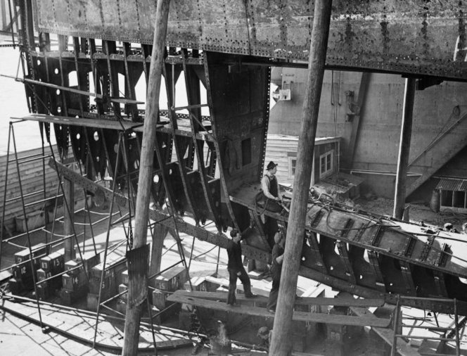 The hull of the ship Wanganella under repair at the floating dock in Wellington. New Zealand Free Lance: Photographic prints and negatives. Ref: PAColl-8602-31. Alexander Turnbull Library, Wellington, New Zealand. http://natlib.govt.nz/records/22891134