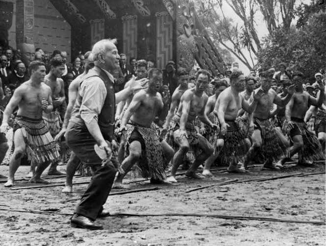 Photograph of Apirana Ngata taking the lead in a haka on Waitangi Day at the centennial celebrations at Waitangi, taken by Bert Snowden  http://natlib.govt.nz/records/22311984