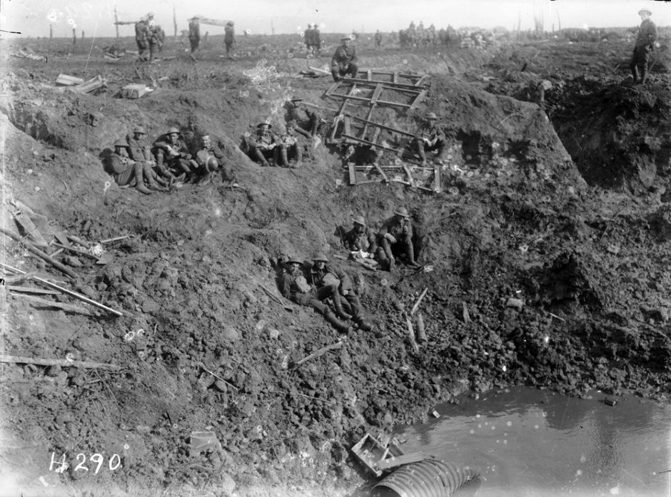 New Zealand engineers resting in a large shell crater at Spree Farm following the First Battle of Passchendaele, 12 October 1917.[Alexander Turnbull Library]