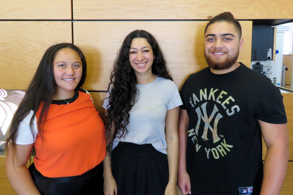 Three Māori youths smiling