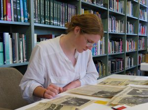 Caitlin Lynch in the Jonathan Dennis Library