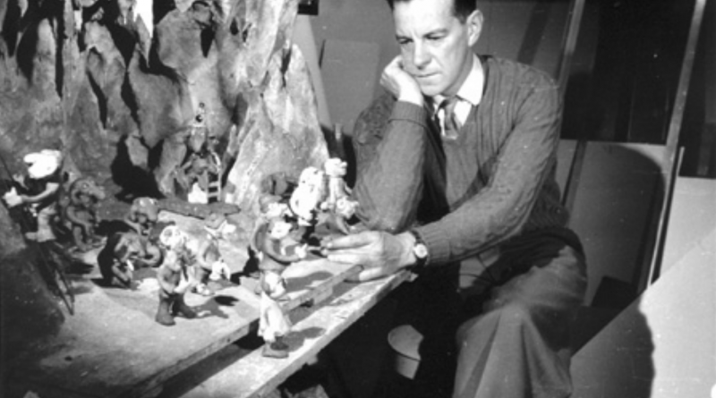 Fred O'Neill with some of his Enchanted Forest figures.