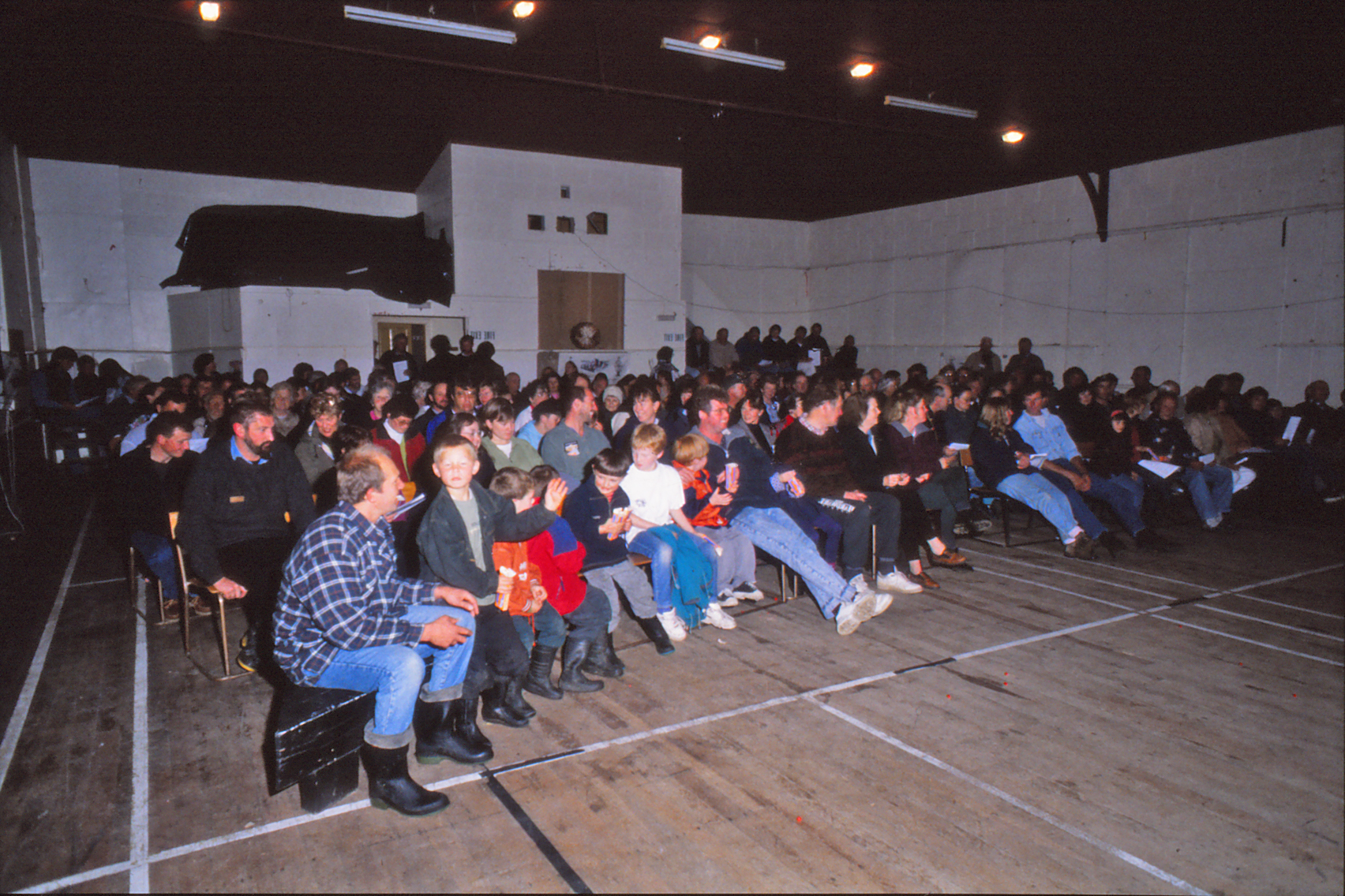 An audience waits for the movie to start in a hall in Southland