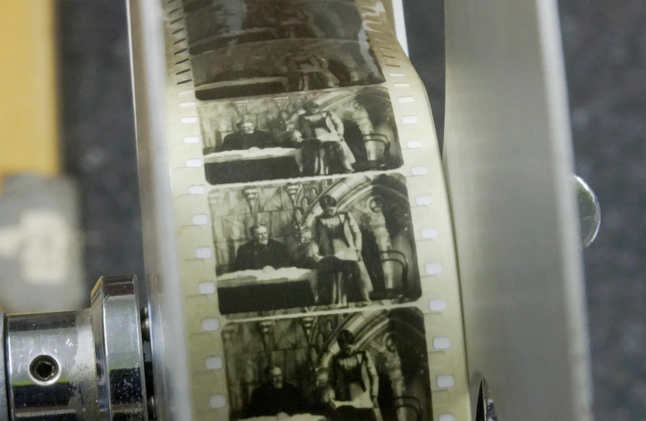 Close up of an old film, 'The World's First Lady Mayor'
